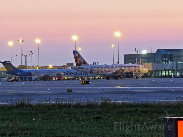 Airbus A319 (N951FR) - Twilight on the ramp at RFD