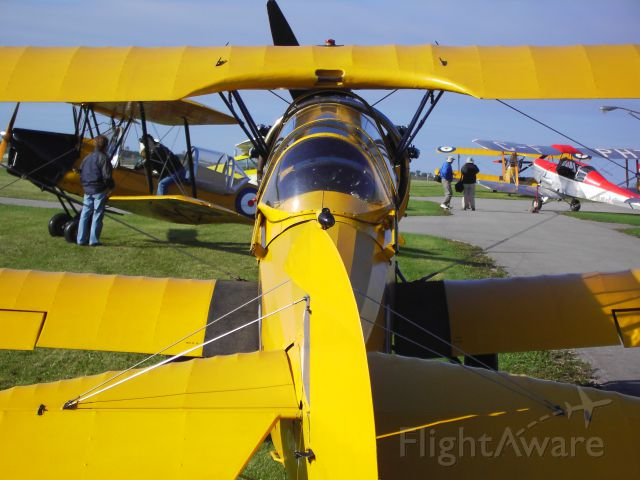 OGMA Tiger Moth — - Believed to be the worlds largest collection of operational de Havilland Tiger Moths.  This airpark in Guelph has an all volunteer group who restores these aircraft.