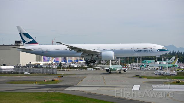 BOEING 777-300 (B-KQR) - BOE249 on final to Rwy 16R to complete a flight test on 10/3/14. (LN:1240 / cn 41759).