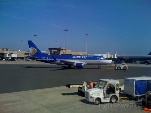 Embraer 170/175 (RPA2016) - New Embraer 170 repainted in Midwest colors being towed to the gate.