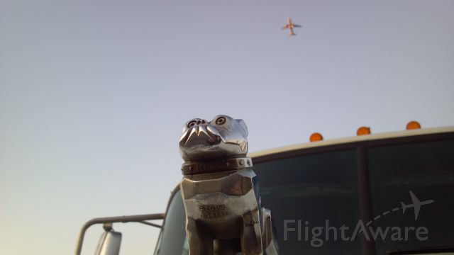 — — - Watching the planes taking off from KSEA while at work driving my United States Postal Service Mack Truck.