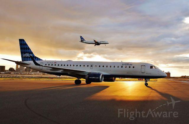 Embraer ERJ-190 (N228JB) - Sun sets on both JetBlue fleet types 06/12/13 !