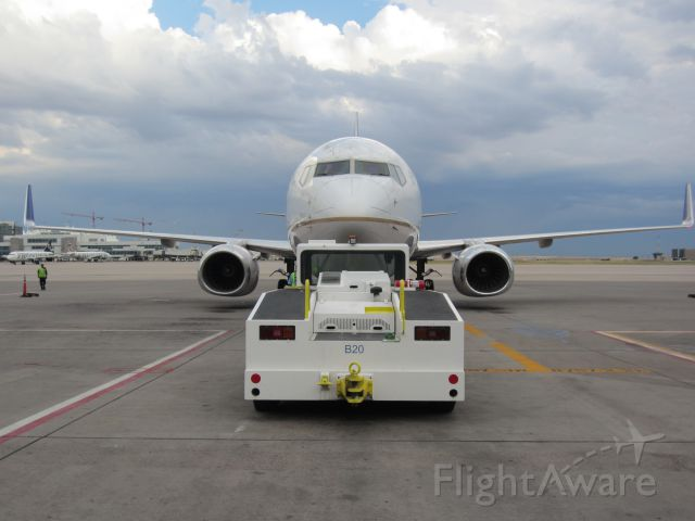 Boeing 737-800 — - Snapped this shot after my crew  and i were done loading and in the middle of pushback.