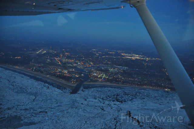 Cessna Cutlass RG (N9421D) - % miles or so from Benton Harbor looking back toward the airport from over the ice covered lake.