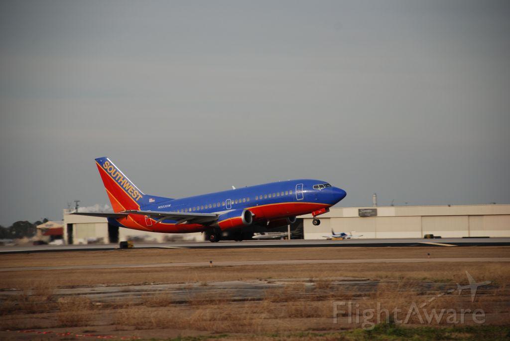 Boeing 737-500 (N503SW) - Southwest 737-500 taking off at KHOU
