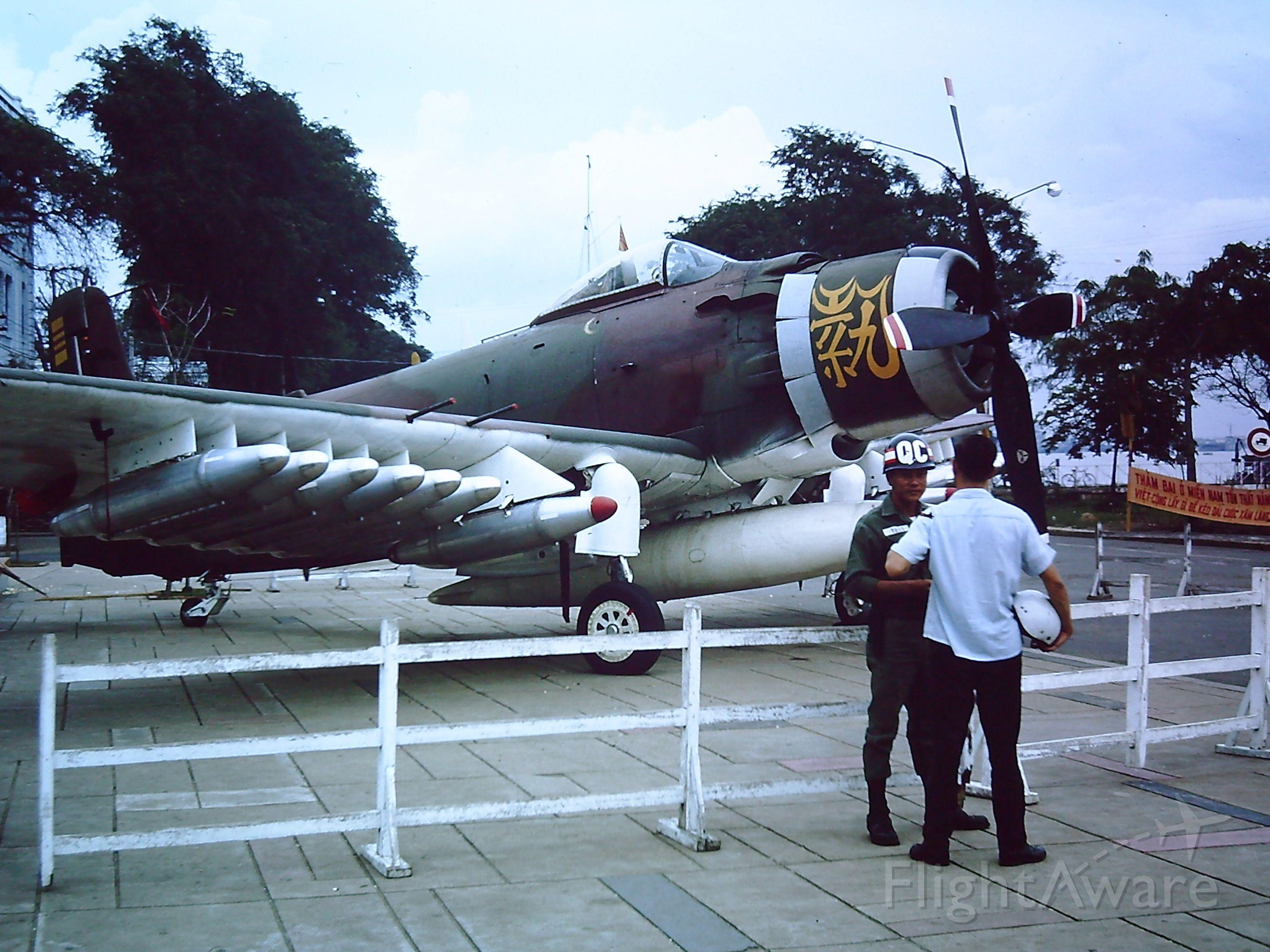 — — - TAN SON NHUT AIR BASE, SAIGON, VIETNAM 1966 - A South Vietnamese Air Force A-1E Skyraider on display in Saigon.
