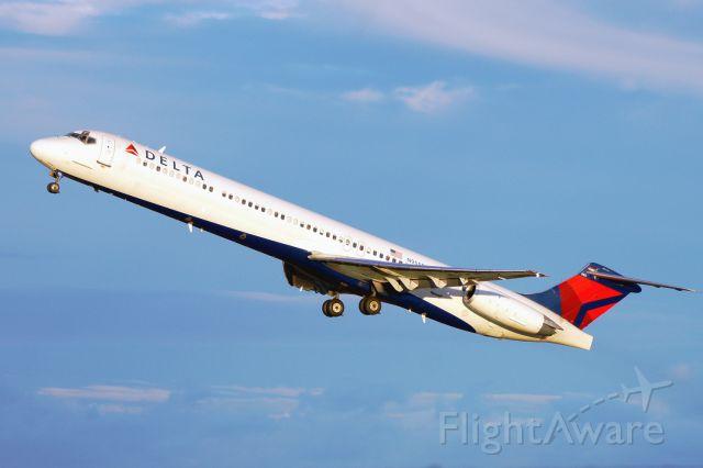 McDonnell Douglas MD-88 (N955DL) - 30L departure at sunset.