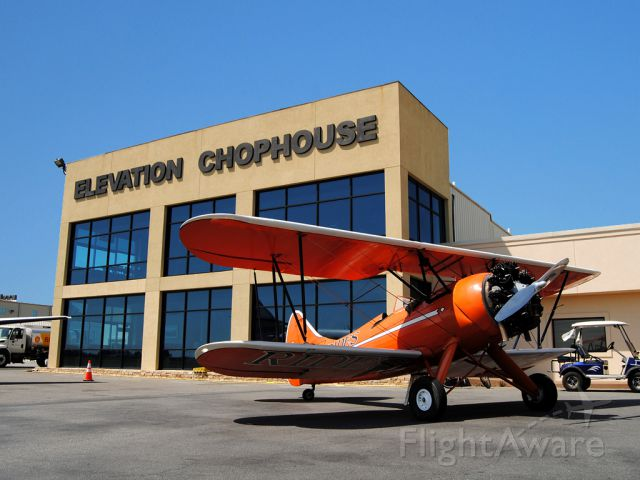 WACO O (N164) - Owned by Bi-Plane Adventures at the Cobb County Airport (KRYY), this WACO is only outshone by the excellent food of the Elevation Chophouse in the background.  I highly recommend this stop if youre ever in the area!!