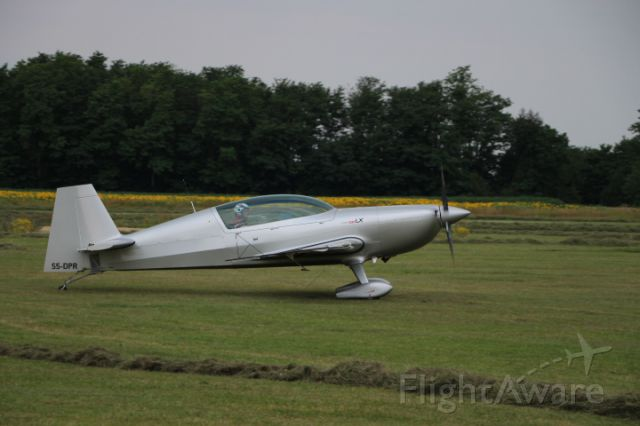 S5-DPR — - World famous aerobatic pilot Peter Podlunsek in his Extra.