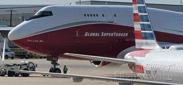 Boeing 747-400 (N744ST) - Global Super Tanker firefighting plane landed about an hour ago at San Antonio International Airport.  Image taken facing ST Engineering hangars from nearby parking garage.