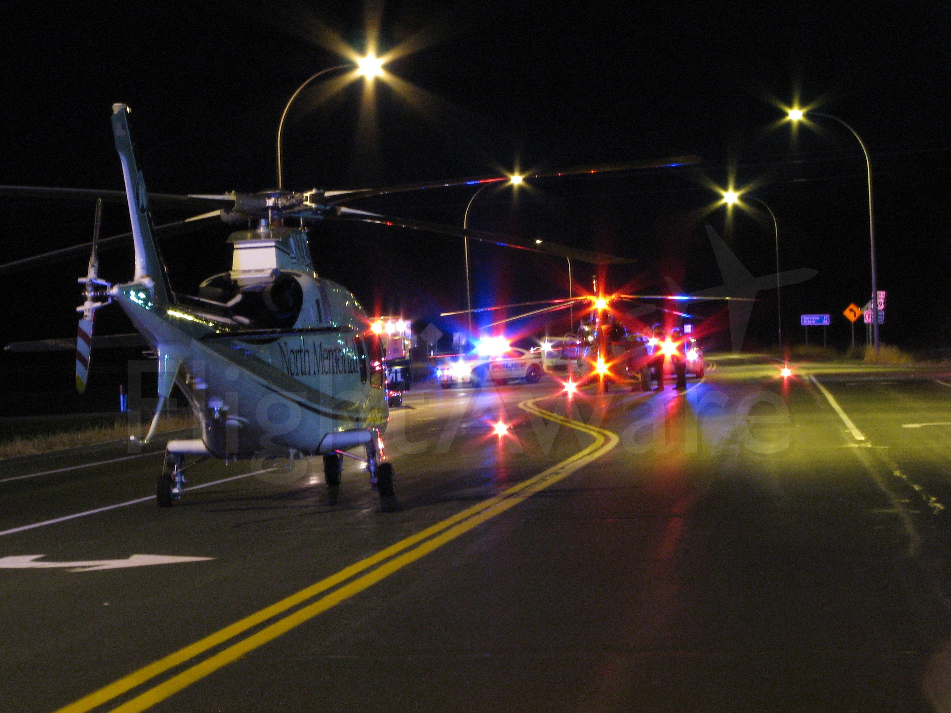 SABCA A-109 (N10NM) - Two Air Care ships at a crash scene in Minnesota