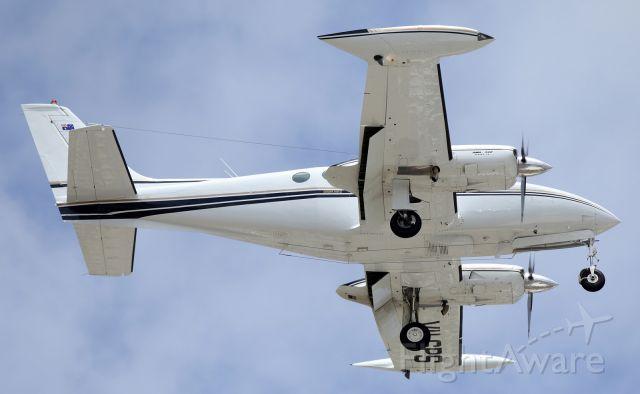 — — - A Twin Cessna, on short finals for runway 01 at YBTL.