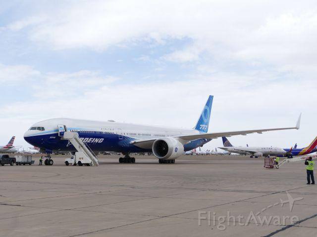Boeing 777-200 (N779XW) - GE Technician taking picture