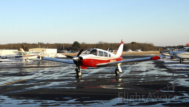 Piper Cherokee (N913FL) - Our Arrow taxiing at Mansfield, MA, home from Maine with a bright new paint job.