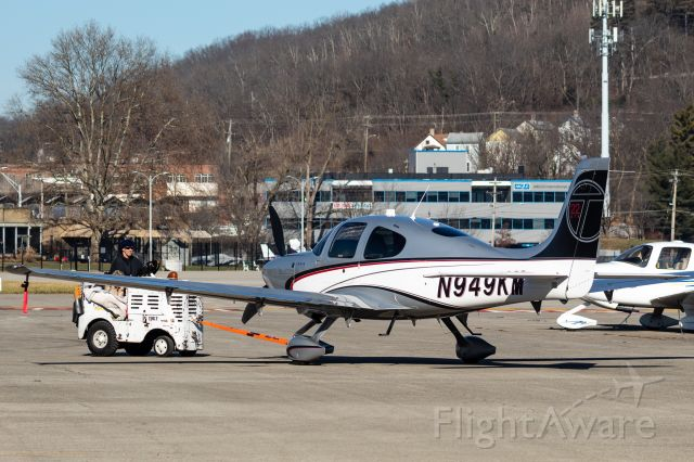 Cirrus SR22 Turbo (N949KM) - A SR-22 Turbo being moved into a hangar at Lunken Airport.