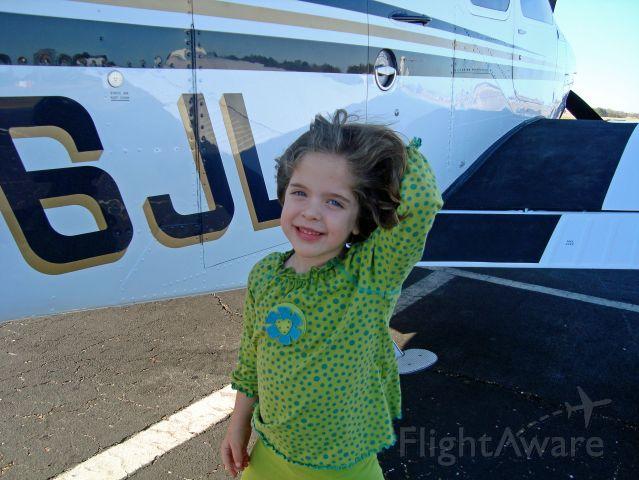 Beechcraft Bonanza (36) (N136JL) - Posing with her new plane...