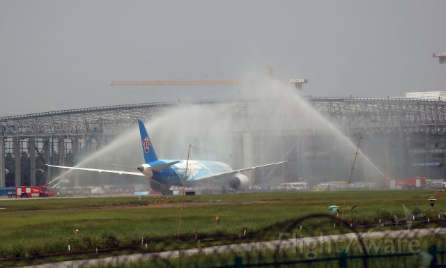 Boeing 787-8 (B-2725) - China first Boeing 787 has deliveried to China Southern Airlines and come back to its home hub Guangzhou Baiyun International Airport for the first time this morning. Welcome water gate in the airport.