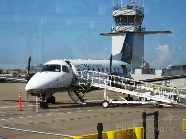 Embraer EMB-120 Brasilia (N233SW) - 1995 Embraer EMB-120ER<br />Parked at McClellan-Palomar Airport, Carlsbad, CA
