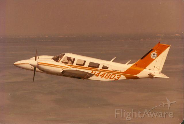Piper Seneca (N44803) - Piper Seneca over Biscayne Bay from Pelican Aviation, Nort Perry Airport, Spring 1980.