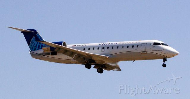Canadair Regional Jet CRJ-200 (N453SW) - United Express on short final for runway 11R at Fresno Yosemite Int.