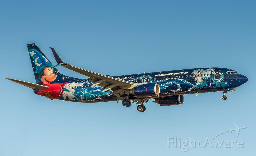 Boeing 737-800 (C-GWSZ) - Westjet Mickey on finals for runway 05 at YYZ