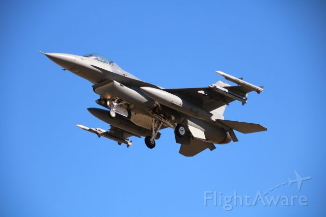 — — - F-16 landing at MARCH ARB