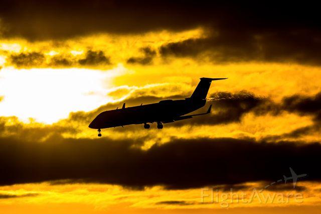 Canadair Regional Jet CRJ-200 (N699BR) - Skywest Flight 5593 on short final from San Francisco just as the sun was setting.