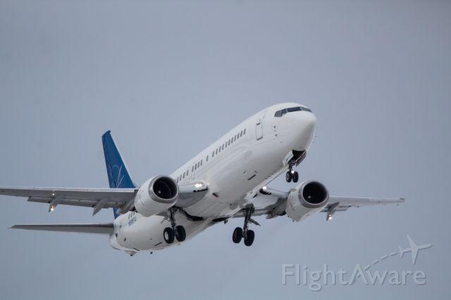 BOEING 737-400 (N806TJ) - Swift Air 737-400 taking off 21R bound for Raleigh Durham North Carolina.