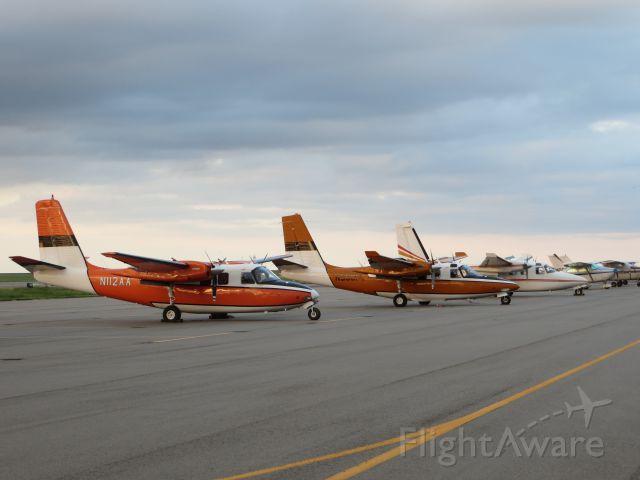 Aero Commander 500 (N112AA) - Three fire spotting/command birds waiting for their season to start.