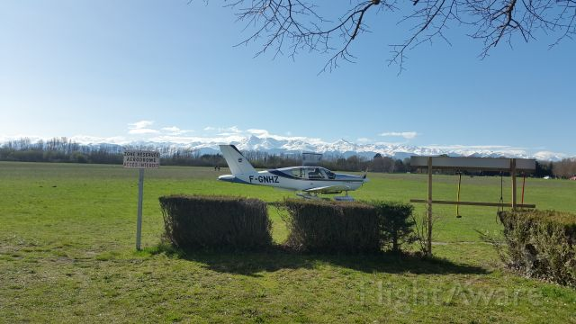 Socata TB-9 Tampico (F-GNHZ) - A Socata Tampico of Aréoclub de Bigorre flight school, France, against le backdrop of majestic Pyrenees cordillera