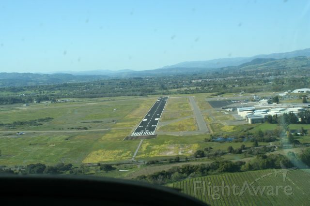 — — - Turning final Runway 32 KSTS