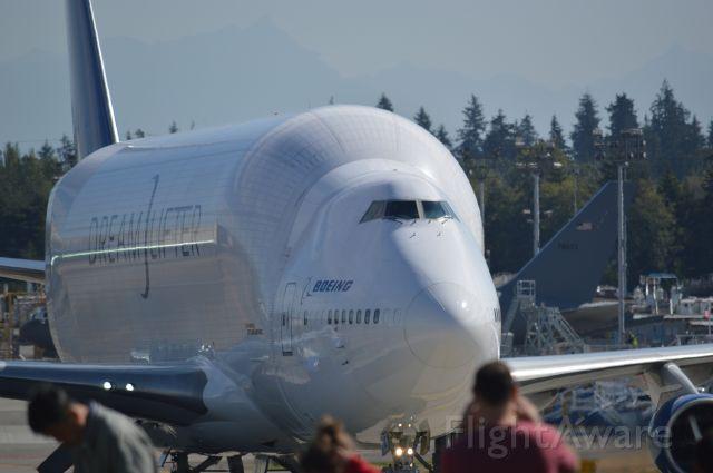 — — - Paine Field bringing in Dreamliner fuselage.