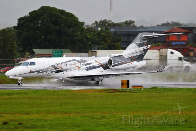Cessna Citation Longitude (N616NP) - EJM700 departing a wet RWY25 to Sugarland.