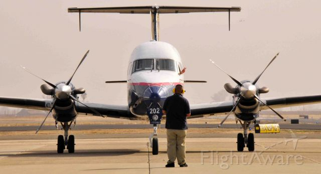 Beechcraft 1900 (N202UX) - START # 2! (note pilots hand poking out the aircraft window)