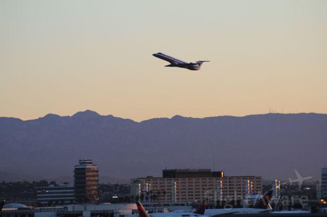 Embraer ERJ-135 (N858AE) - American Eagle ERJ140 taking off from LAX 03/09/11.