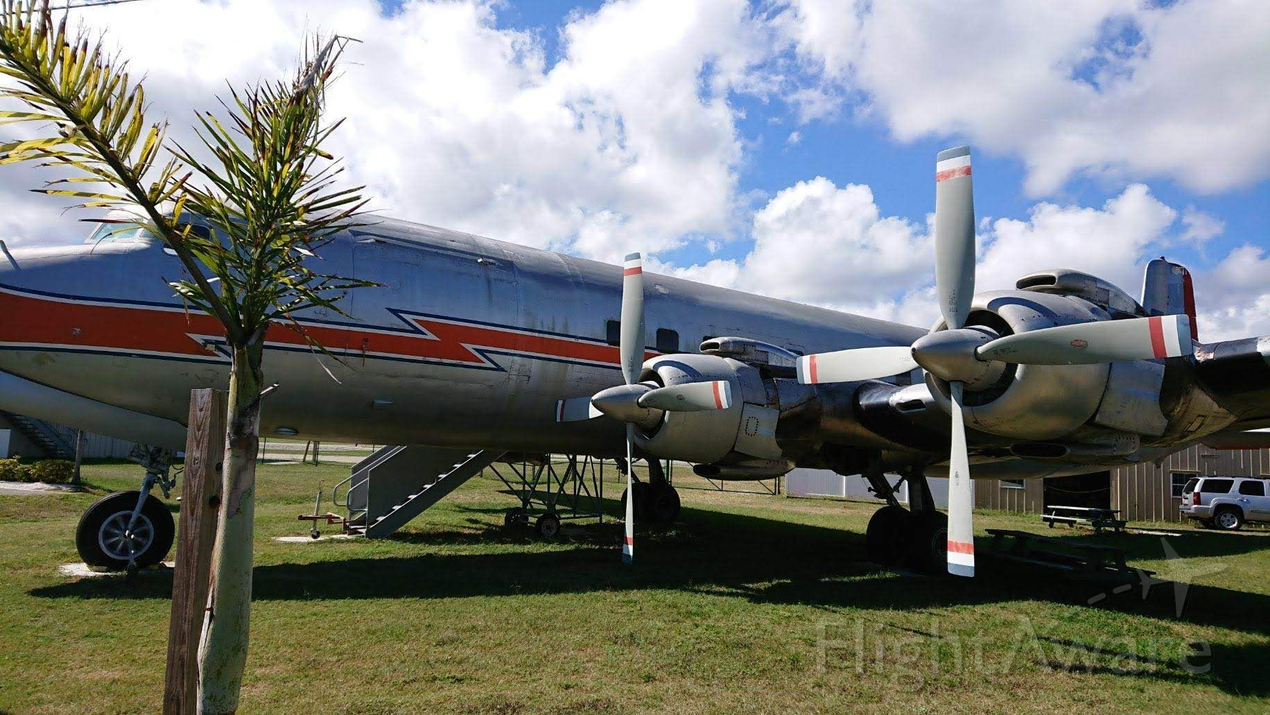 Douglas DC-7 (N381AA) - A classic DC-7 resting among some palm trees in New Smyrna, FL.