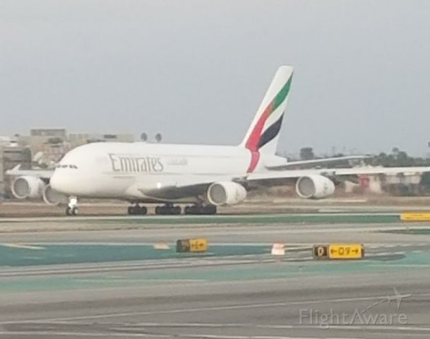— — - Emirates-UAE Airbus 388 at full throttle--LAX