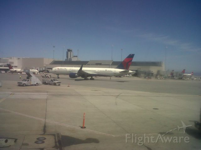 — — - Delta 757 WL on the apron at KSFO. Picture taken from aboard AWE 658 (A320 service from SFO-PHL). Date 4-16-12. Sorry for the low quality.