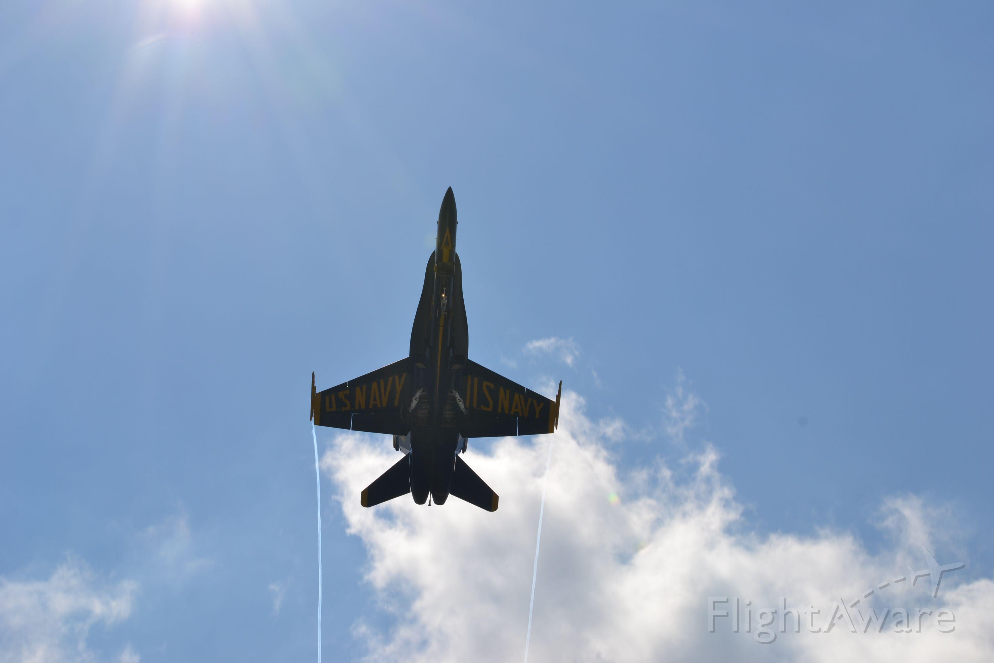 McDonnell Douglas FA-18 Hornet — - Blue Angel on approach to KBOS, War of 1812 commemoration 2012