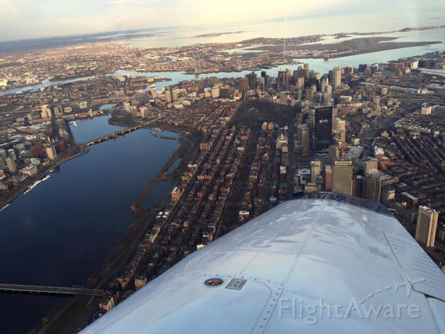 Piper Cherokee (N724CA) - Orbiting the city of Boston west of the RWY 22R/L centerlines
