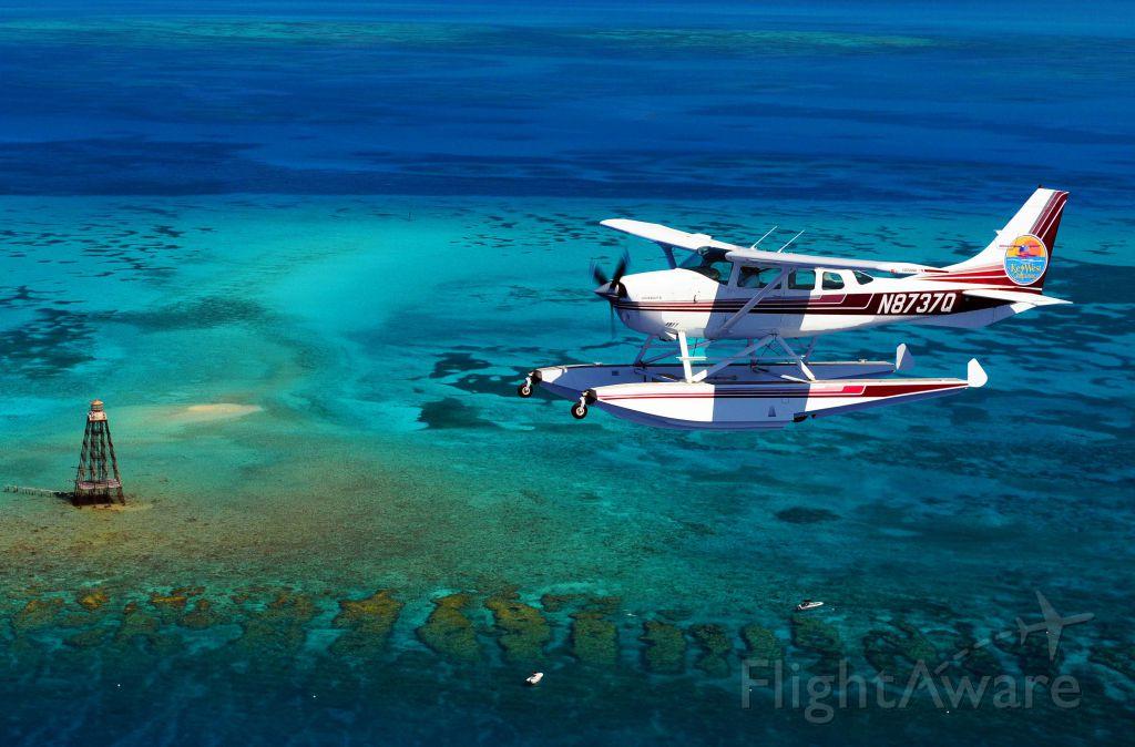 Cessna 206 Stationair (N8737Q) - Key West Seaplanes.com Sand Key Lighthouse near Key West FL