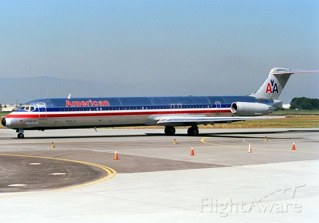 McDonnell Douglas MD-80 (N437AA) - KSJC - June 1988 view of a fairly new MD-80 for American as it taxis to the gate at SJC. This parking lot was temp as the then new Terminal A construction had just begun, allowing for almost 3yrs of filming this close to the jets!
