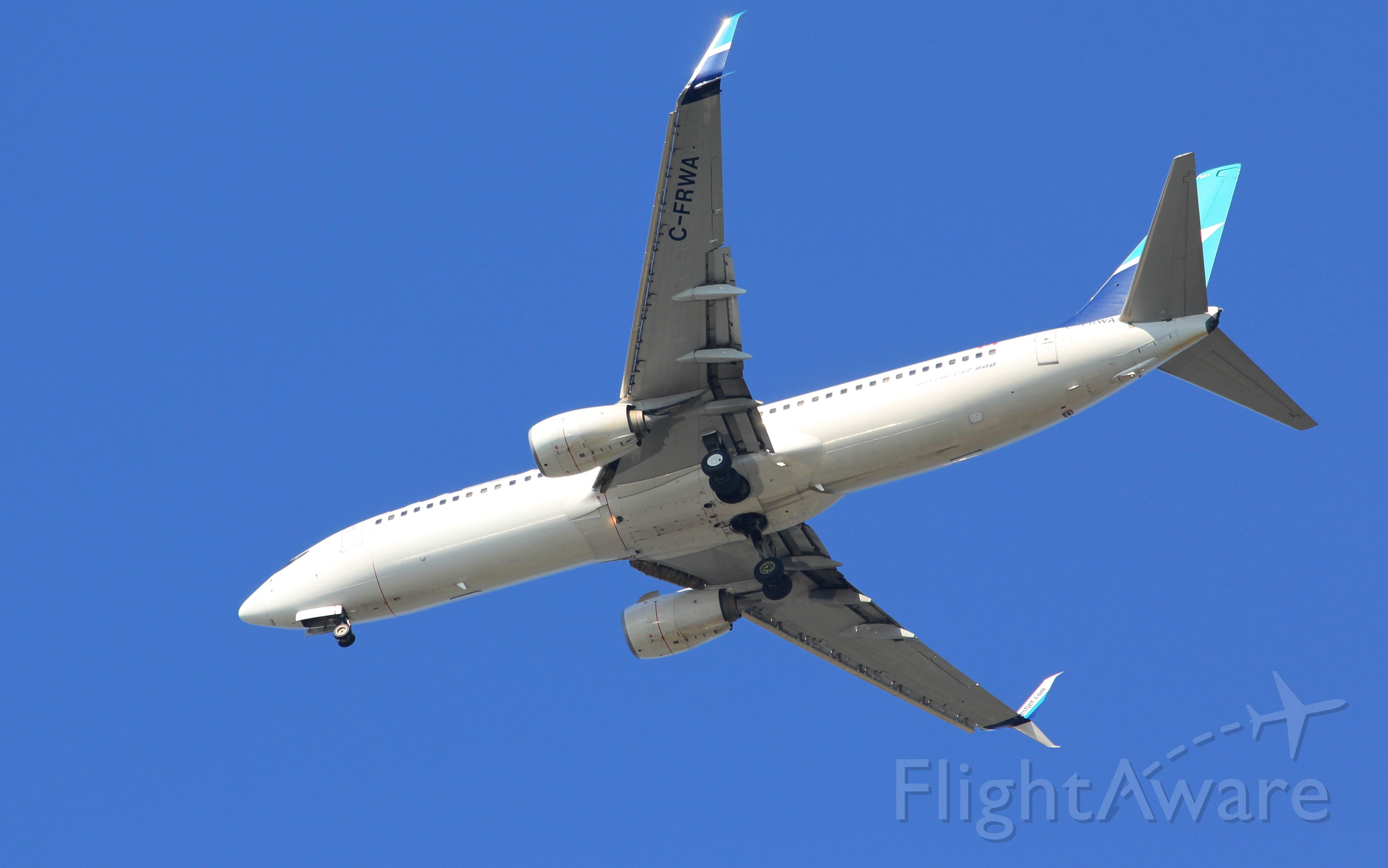 Boeing 737-800 (C-FRWA) - Nice early morning shot from my front yard.