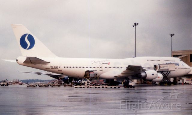 BOEING 747-300 (OO-SGD) - Sabena B747 being serviced at Boston Logan's Terminal E on March 14, 1998.