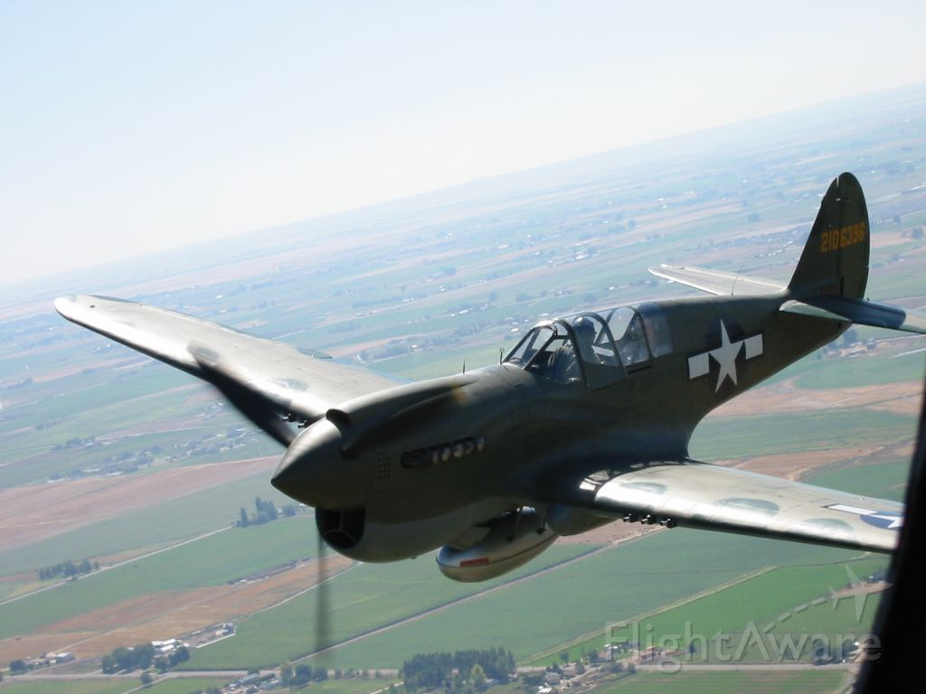 CURTISS Warhawk (N1195N) - My dad got to go up in a B-25, and he was joined by a P-40.  This P-40 has a new nose paint with the parrot.