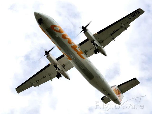 de Havilland Dash 8-300 (C-GETA) - Arriving from BOS/KBOS. Rwy 24L.
