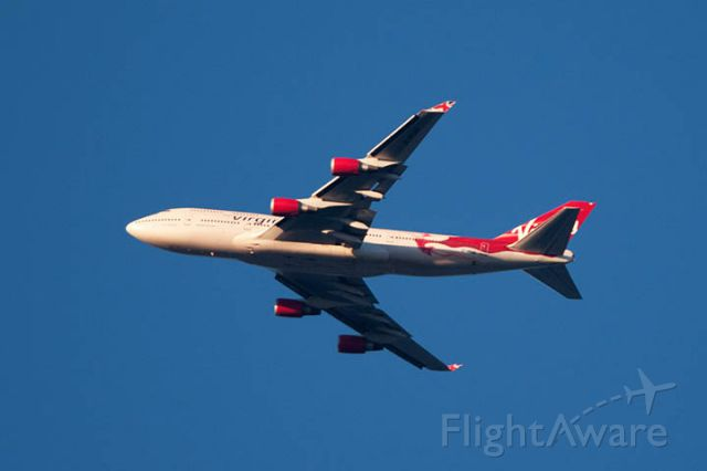 Boeing 747-400 (G-VFAB) - 12/9/12:  Virgin flight #5 on a downwind leg over Miami Lakes before an approach in front of the sunset enroute to runway 12 at MIA.  Photo taken from my balcony in Miami Lakes.