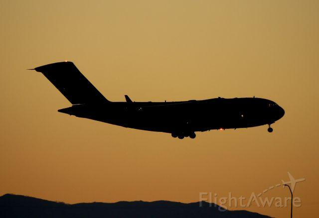 Boeing Globemaster III — - C-17 coming into 35L at dusk.
