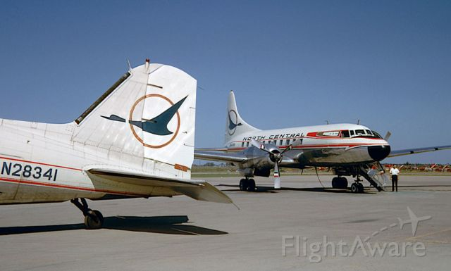 """N8444H — - I had just come off N8444H Convair 440 Metropolitan (327A) of North Central Airlines """"NC763"""" at Aberdeen, South Dakota, completing my leg number twelve on this airframe in two days, it was a good time to get off and stretch my legs as I had to travel two more to Bismark and finally end up at Minot. N28341 Douglas DC-3 Dakota (3278) was gracing the small ramp. My heart goes where the wild goose goes, well """"Herman"""" anyways!"""