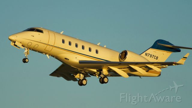 Bombardier Challenger 300 (N797CB) - 31L departure just before sunset.